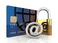karta kredytowa, kłódka i małpa